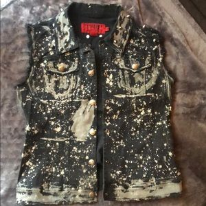 Cute, distressed, studded vest